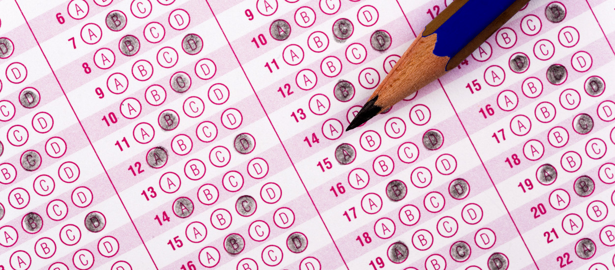 ACT scantron with pencil laying on it