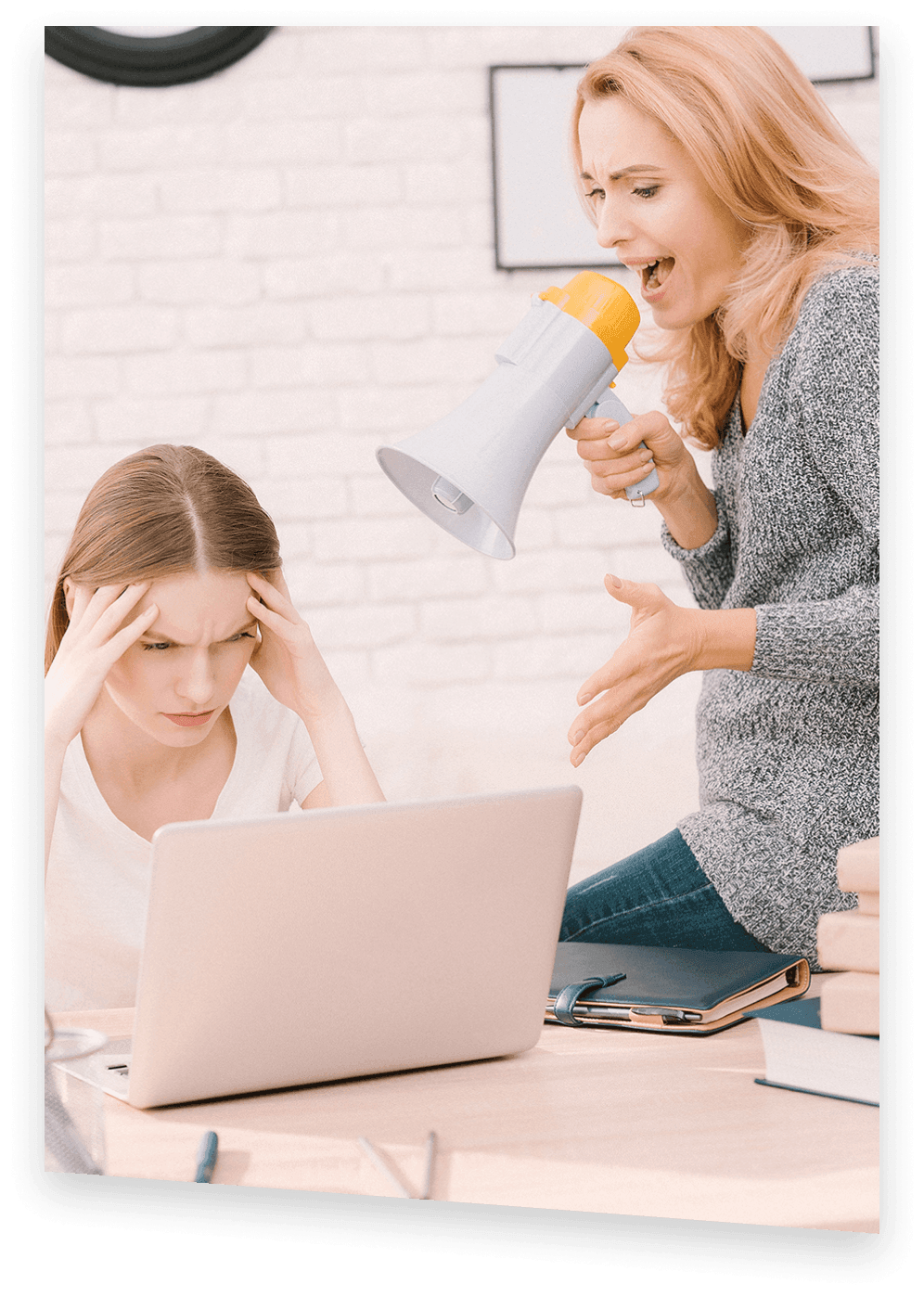 Angry mother screaming with a megaphone at distraught daughter troubled with misunderstanding of her big amount of coursework